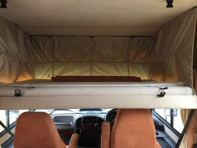 Double bed above the driving area