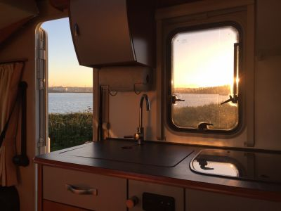 Enjoying a Cornish sunset from the comfort of Demelza Motorhome